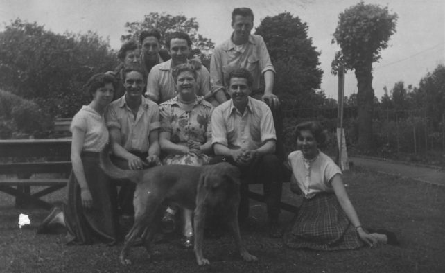 Group of adults with a dog.