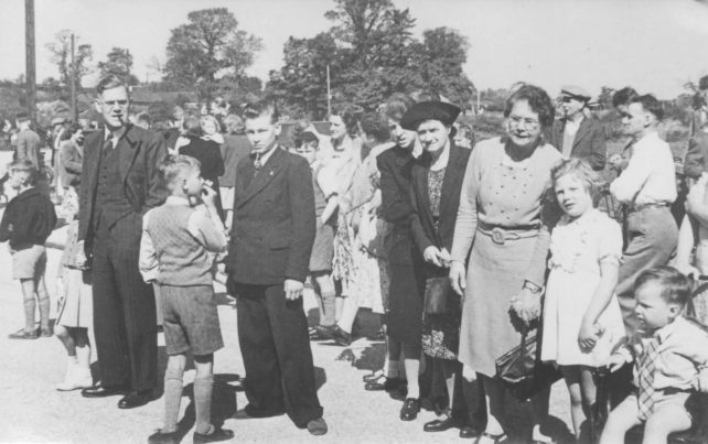 Group of adults and children outside.