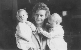 Woman holding two babies.