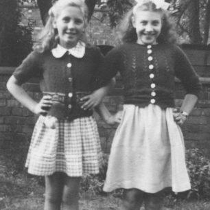Two girls. Posing in a garden.