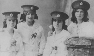 Four Girls in military hats. During 1914-18 War.