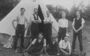 Eight men with a tent. On right Perce Eldred.