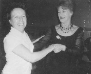 Two ladies dancing.