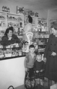 Inside of sweet shop, with groceries as well.