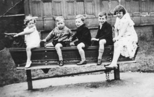 Children on long rocking horse in playground