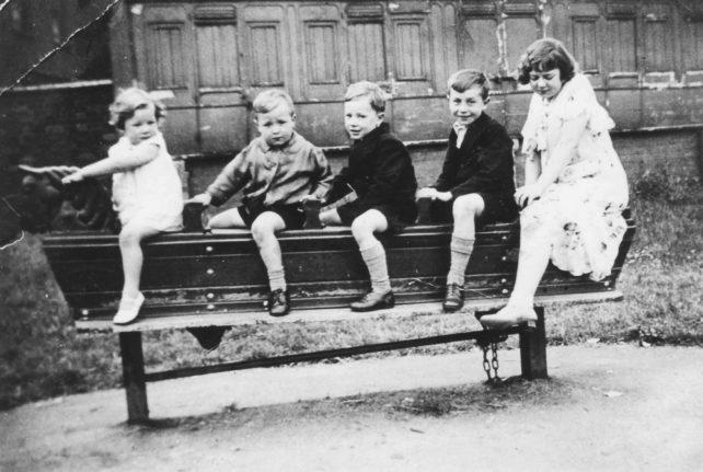 Children on long rocking horse in playground