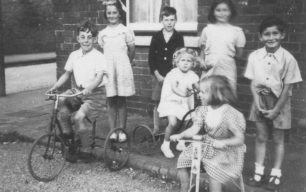 Children and tricycles at Corner Pin, New Bradwell