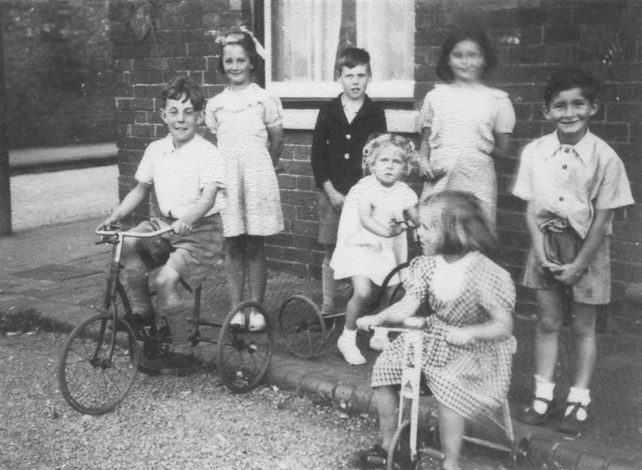 Children and tricycles at Corner Pin
