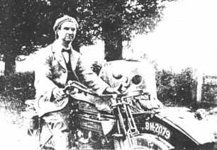 Mr Casebrook on motor bike with sidecar