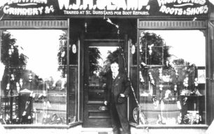W J H Clamp's shop front, with the man himself, possibly in the  High Street.