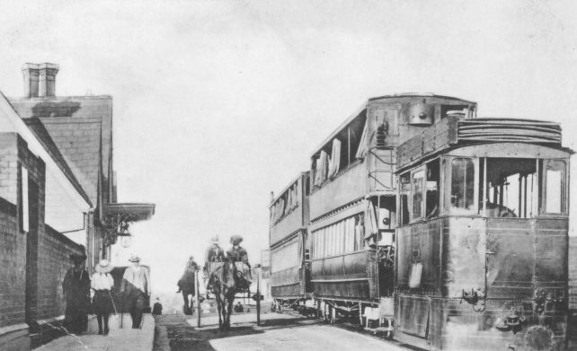 Steam Tram at Wolverton Station with Goodman's horse drawn cart beside it