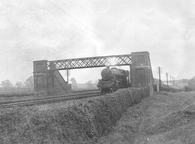 Steam Train under footbridge at Old Bradwell