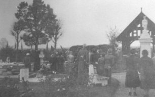 The service of dedication of the  Little Soldier statue in New Bradwell Cemetery.