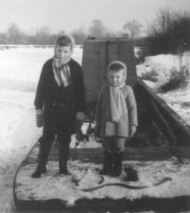 Graham & Andrew Crisp in 1963 Winter snow on a canal boat.