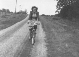 Mrs Olwen Crisp cycling along Little Linford Lane.