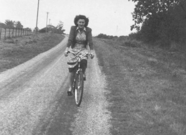 Mrs Olwen Crisp cycling along Little Linford Lane.