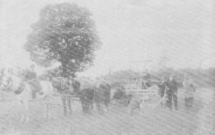 Horse drawn agricultural machine.