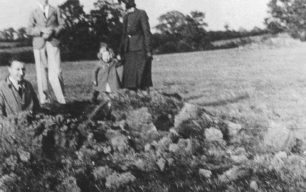 George Clarke, Ron Shouler, Norma Clarke, Mrs May Clarke nee Shouler at the 1940 bomb crater in Loughton Rd, Old Bradwell