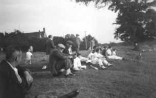 Watching a cricket match from the bank on the  field c1951.