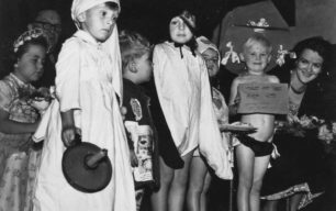 1950 Lady Hesketh judging the children's fancy dress competition.