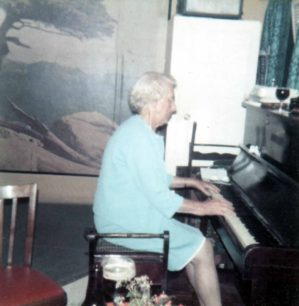 Mrs Dot Brown at the piano.