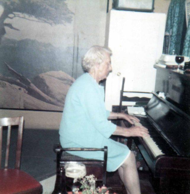 Mrs Dot Brown at the piano.