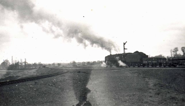 Steam engine and goods train on the Oxford line at Three Bridges