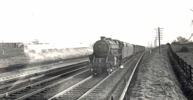 Passenger train travelling north at the Sixty Steps