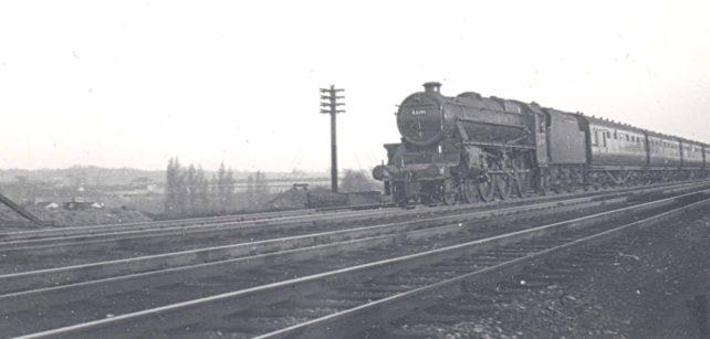 Passenger train nearing Bletchley at the Three Bridges