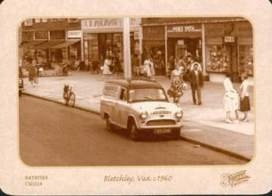 Bletchley Road (Queensway) with a van and shops