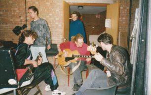 Three guitarists backstage