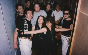 A dozen band members backstage