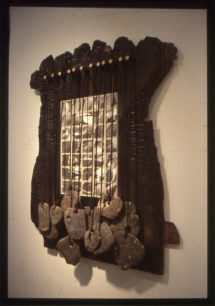 3D burnt wood frame with photos and stones