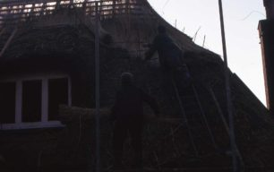 Thatchers repairing the roof of The Swan Inn