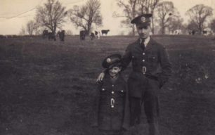 Man & boy in military uniform