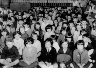 Infants seated on the floor in the hall 1969/70
