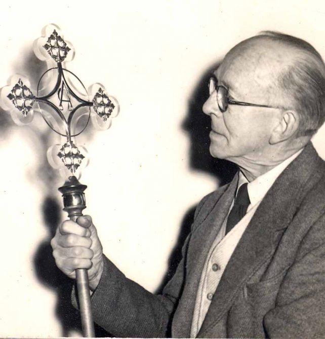 Gentleman looking at an ornate cross