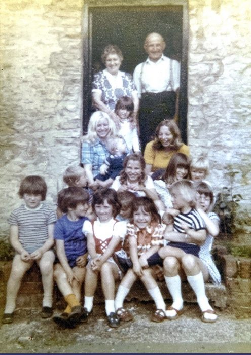 Granny and grandchildren out side the cottages