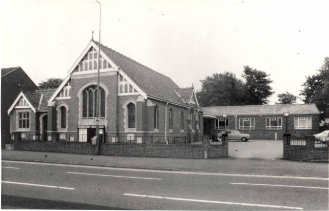 Church exterior with hall and car park