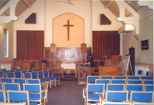 Church front interior with new chairs
